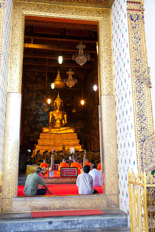 Wat Suthat Thepphawararam is a royal temple of the first grade, one of ten such temples in Bangkok, (23 in Thailand). Construction was begun by His Majesty King Rama I in 1807. Further construction and decorations were carried out by King Rama II who helped carve the wooden doors, but the temple was not completed until the reign of King Rama III in 1847. This temple contains the Buddha image Phra Sri Sakyamuni or &quot;Sisakayamunee&quot; which moved from Sukhothai province. At the lower terrace of the base, there are 28 Chinese pagodas which mean the 28 Buddhas born on this earth. Wat Suthat also contains Phra Buddha Trilokachet in the Ubosot (Ordinary Hall) and Phra Buddha Setthamuni in Sala Kan Parien (Meeting Hall).<br /> In 2005, the temple was submitted to UNESCO for consideration as a future World Heritage Site.