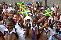 Schoolgirls waving flags and cheering