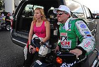 Jan 24, 2009; Chandler, AZ, USA; NHRA funny car driver John Force with daughter Courtney Force during testing at the National Time Trials at Firebird International Raceway. Mandatory Credit: Mark J. Rebilas-