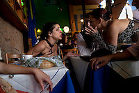 Ceci (left) gets into a fight with her boss at a restaurant in the El Caminito area of Buenos Aires where she works as a tango dancer. Ceci is in trouble because she was late. She was late because she was at school.