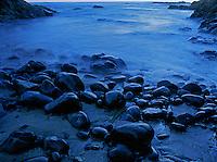 769550003 presunrise on beach rocks and pacific ocean surf along the coastline south of bandon oregon