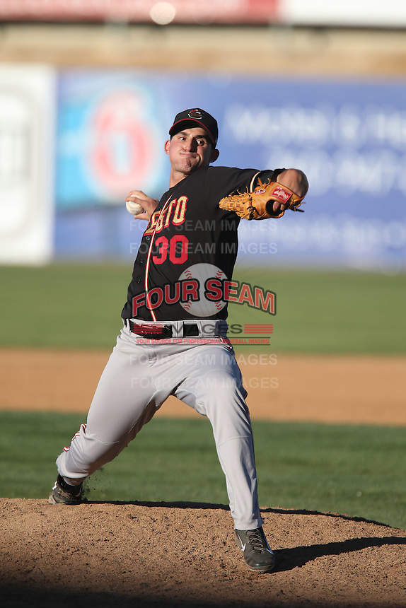 Alving Mejias #30 of the Modesto Nuts pitches against the High Desert Mavericks at Heritage Field on June 29, 2014 in Adelanto, California. High Desert defeated Modesto, 6-1. (Larry Goren/Four Seam Images)