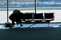 Man waiting for a flight at Cleveland Hopkins International Airport.