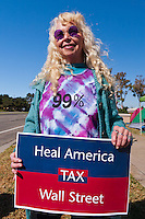 """Marion, in her awesome round purple sunglasses, holds a """"Heal America, tax Wall Street"""" sign at the Occupy Orange County, Irvine camp on November 5."""