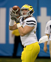 Zach Johnson of Michigan catches the ball during warm up before Sugar Bowl game against Virginia Tech at Mercedes-Benz SuperDome in New Orleans, Louisiana on January 3rd, 2012.  Michigan defeated Virginia Tech, 23-20 in first overtime.