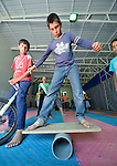 Boys learn circus skills as part of a psycho-social program run by Finn Church Aid in the Zaatari refugee camp near Mafraq, Jordan. Established in 2012 as Syrian refugees poured across the border, the camp held more than 80,000 refugees by early 2015, and was rapidly evolving into a permanent settlement. Finn Church Aid is a member of the ACT Alliance, which provides a variety of services to refugees living in the camp.