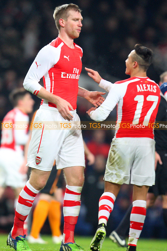 Per Mertesacker of Arsenal is congratulated after scoring the opening goal - Arsenal vs Hull City - FA Cup third round action at the Emirates Stadium on 04/01/2015 - MANDATORY CREDIT: Dave Simpson/TGSPHOTO - Self billing applies where appropriate - 0845 094 6026 - contact@tgsphoto.co.uk - NO UNPAID USE