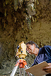 Wasisto uses a Theodolite to survey the 2009 dig sites at Liang Bia cave.