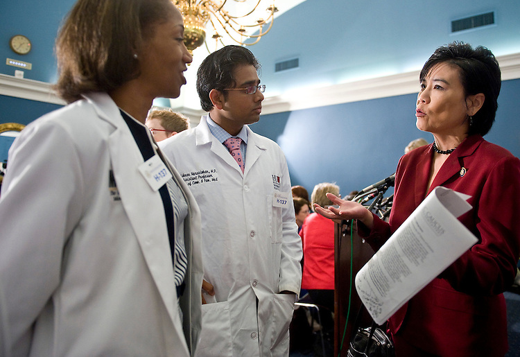 From left, Dr. Willarda Edwards, M.D., president-elect National Medical Association, and Dr. Krishnan Narasimhan, M.D, of Howard University, speak with Rep. Judy Chu, D-Calif., before the start of a news conference on the healthcare bill on Tuesday, July 21, 2009.
