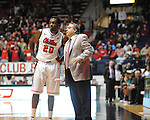 "Ole Miss' Nick Williams (20) and assistant coach Sergio  vs. Coastal Carolina at the C.M. ""Tad"" Smith Coliseum in Oxford, Miss. on Tuesday, November 13, 2012. (AP Photo/Oxford Eagle, Bruce Newman)"