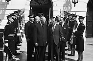 31 Mar 1969, Washington, DC, USA --- United States President Richard Nixon and French President Charles de Gaulle exiting the White House for the funeral of President Dwight Eisenhower on March 31, 1969. The eulogy was later delivered by President Richard Nixon during funeral services at the National Cathedral. --- Image by © JP Laffont/Sygma/CORBIS