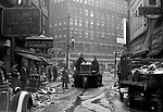 Pittsburgh PA:  View down Market Street toward Liberty Avenue after the Flood - 1936.  About 100,000 buildings were destroyed and the damage was estimated at about $250 million. Sixty five percent of the downtown business district had been under water from the Point all the way up to Grant Street.