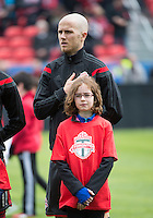 Toronto, Ontario - May 3, 2014: Toronto FC midfielder Michael Bradley #4 during the opening ceremonies in a game between the New England Revolution and Toronto FC at BMO Field.<br /> The New England Revolution won 2-1.