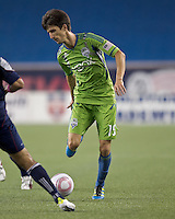 Seattle Sounders midfielder Alvaro Fernandez (15) controls the ball. In a Major League Soccer (MLS) match, the Seattle Sounders FC defeated the New England Revolution, 2-1, at Gillette Stadium on October 1, 2011.
