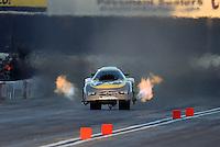 Nov 11, 2016; Pomona, CA, USA; NHRA funny car driver John Hale does a wheelstand during qualifying for the Auto Club Finals at Auto Club Raceway at Pomona. Mandatory Credit: Mark J. Rebilas-USA TODAY Sports