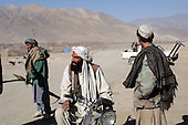 Maidan Shaher, Afghanistan<br /> November 25, 2001<br /> <br /> The Taliban receive the Northern Alliance and journalist into the district of Maidan Shaher after a truce is struck between the two forces. Just two days ago the two fought each other in a serious battle over the territory.