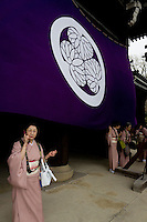 women in traditional kimono  after spring time ceremony in Shinto temple in Kyoto, Japan
