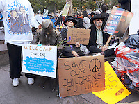 USA. New York City. Occupy Wall Street (OWS) is a people-powered movement that began on September 17, 2011 in Liberty Square in the Wall Street financial district of Manhattan. The protesters have created a small campsite at the Zuccotti Park site. OWS and has spread to over 100 cities in the United States and actions in over 1,500 cities globally. OWS is mainly protesting social and economic inequality, corporate greed, corruption and influence over government&mdash;particularly from the financial services sector&mdash;and lobbyists.  It is fighting back against the corrosive power of major banks and multinational corporations over the democratic process, and the role of Wall Street in creating an economic collapse that has caused the greatest recession in generations. The protesters' slogan, &quot;We are the 99%&quot;, refers to the difference in wealth and income growth in the U.S. between the wealthiest 1% and the rest of the population. OWS aims to expose how the richest 1% of people are writing the rules of an unfair global economy that is foreclosing on our future. OWS has being organized using a non-binding consensus based collective decision making tool known as a &quot;people's assembly&quot;. Save our children future. Make love, not war. 25.10.2011 &copy; 2011 Didier Ruef