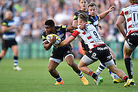 Kyle Eastmond of Bath Rugby takes on the Gloucester defence. West Country Challenge Cup match, between Bath Rugby and Gloucester Rugby on September 26, 2015 at the Recreation Ground in Bath, England. Photo by: Patrick Khachfe / Onside Images