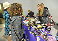 NWA Democrat-Gazette/Michael Woods --04/30/2015--w@NWAMICHAELW...  Becca Stevens founder of Thistle Farms-Magdalene, a community of women who have survived prostitution, trafficking and addiction, helps out selling the organizations products Thursday evening during a fundraising event at St. Paul's Episcopal in Fayetteville.  St. Paul's Episcopal plans to start its own Magdalene ministry.