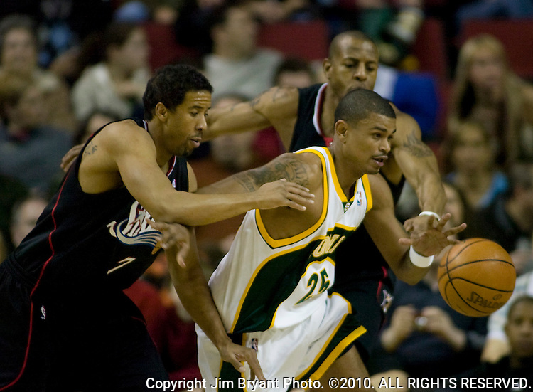 Seattle SuperSonics' Earl Watson, right is turned away from the basket by Philadelphia 76ers' Andre Miller, left, and Andre Iguodala in a NBA basketball game during the first half Monday, Dec. 31, 2007 in Seattle.  Jim Bryant Photo. ©2010. All Rights Reserved.