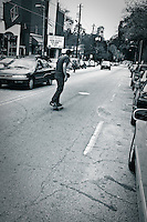 A skateboarder makes his way down Euclid Avenue in Little Five Points.