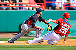 4 March 2011: Washington Nationals first baseman Adam LaRoche slides safely into third during a Spring Training game against the Atlanta Braves at Space Coast Stadium in Viera, Florida. The Braves defeated the Nationals 6-4 in Grapefruit League action. Mandatory Credit: Ed Wolfstein Photo