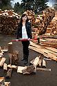 PE00132-00...WASHINGTON - Ruth Spring splitting wood. (MR #S12)