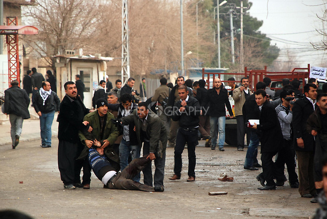 SULAIMANIYAH, IRAQ: A wounded protester is helped by men in the street after Kurdish Iraqi security forces opened fire on a demonstration...Kurdish security forces shot and killed protesters in the northern Iraqi city of Sulaimaniyah...Photo by Sartep Osman