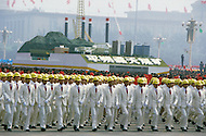Beijing, China. October 1st, 1984. This huge parade is for the celebration of the 35th Anniversary of the Chinesse Revolution. Float of a factory representing progress and research, walking along a huge crowd of engineers.