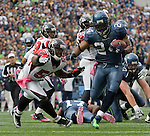 Seattle Seahawks running back Marshawn Lynch runs for an 11-yard touchdown against the Atlanta Falcons at CenturyLink Field in Seattle, Washington on October 2, 2011. The Falcons beat the Seahawks 30-28 . ©2011 Jim Bryant Photo. All Rights Reserved.
