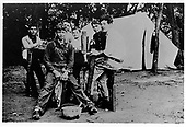 Abilene, Kansas - File photo -- Dwight D. Eisenhower (front) camps out with his boyhood friends near Abilene, Kansas, circa 1904..Credit: U.S. Army Photo via CNP