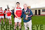 Muiris Ó Fiannachta, West Kerry GAA Chairperson, presenting the West Kerry Senior Championship cuap to Daingean U Chúis captain Breandan Ó Céilleachair at Pairc an Aghasaigh, Dingle, on Sunday afternoon.