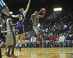"Ole Miss guard Chris Warren (12)  shoots as Louisiana State's Eddie Ludwig (13) defends at the C.M. ""Tad"" Smith Coliseum in Oxford, Miss. on Wednesday, February 9, 2011. Ole Miss won 66-60 and is now 4-5 in the Southeastern Conference."