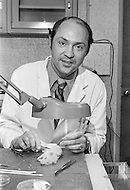 01 Mar 1973 --- Dr. William Summerlin with a laboratory rat at the Memorial Sloan-Kettering Cancer Center in New York. Summerlin hoaxed the medical world with his claims to have transplanted tissue from donors of different unrelated species. He forged the experiment using ink on a white mouse to make it appear that tissue had been grafted successfully from a black rat.
