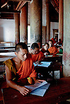 Buddhist novice monks attending school in their temple at Luang Prabang province, Laos. Boys often become novices in order to gain an education.