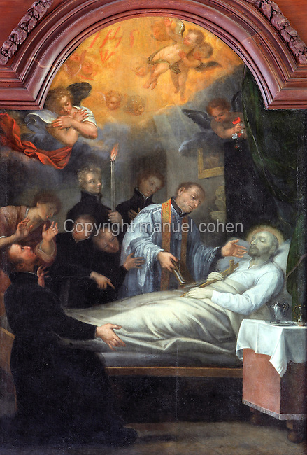 Painting of St Ignatius of Loyola, 1491-1556, founder of the Society of Jesus or Jesuit Order, on his deathbed with a priest administering Last Rites, by Jean Helart, 1618-85, French painter, in the wooden panelling of the refectory of the Ancien College des Jesuites or Former Jesuit College in Reims, Marne, Champagne-Ardenne, France. The scene reflects the event as described in a letter from Jesuit Jean Polanco to his superior in Rome, P Ribadeneira. The College was built 1619-78 and is now the Euro-American campus of Sciences Po, or the Institut d'Etudes politiques de Paris, and the FRAC Champagne-Ardenne. It is listed as a historic monument. Picture by Manuel Cohen