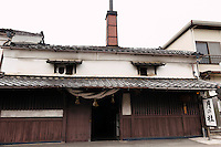 """Exterior of the Tsukinokatsura sake brewery, Fushimi, Kyoto, Japan, October 10, 2015. Tsukinokatsura Sake Brewery was founded in 1675 and has been run by 14 generations of the Masuda family. Based in the famous sake brewing region of Fushimi, Kyoto, it has a claim to be the first sake brewery ever to produce """"nigori"""" cloudy sake. It also brews and sells the oldest """"koshu"""" matured sake in Japan."""