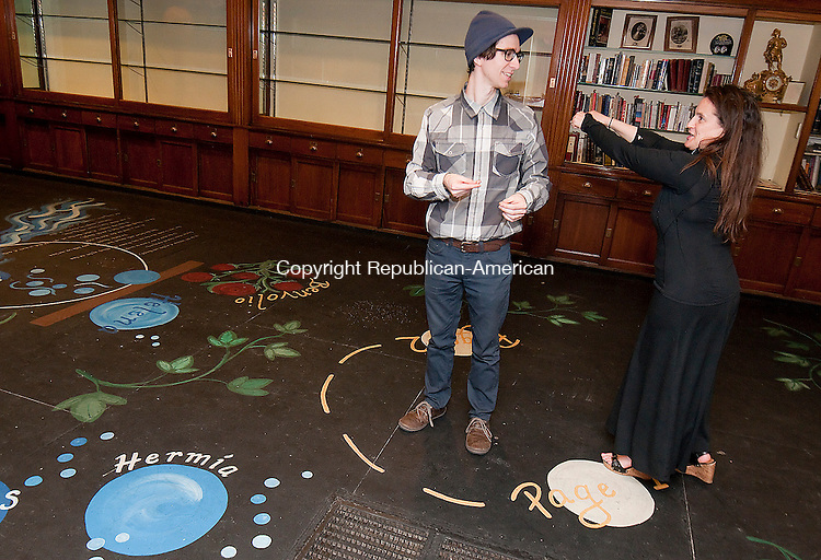 WATERBURY, CT--042215JS07- Resident playwright Jake Green, left, works with Shakesperience Artistic Director Emily Mattina, as  they prepare for the 16-hour Shakespeare marathon held at their Bank Street studio beginning May 5 at 7 a.m. The event, part of the Give Local fundraising campaign, is free and people can drop in at any time.<br /> Jim Shannon Republican-American