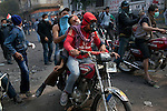 Protesters use motorcycles to transfer wounded on Mohamed Mahmoud Street to a field hospital near Tahrir Square in Cairo, Egypt, Tuesday, November 22, 2011. Clashes between Central Security Forces and demonstrators against military rule continued into a fourth day.