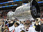 June 9, 2010; Philiadelphia, PA; USA;  Chicago Blackhawks center Jonathan Toews (19) raises the cup overhead after the Blackhawks defeated the Flyers 4-3 in Game 6 of the Stanley Cup Finals at the Wachovia Center.