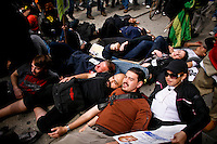 Occupy Wall Street members goes down during a  march against police brutality in New York, United States. 24/03/2012.  Photo by Eduardo Munoz Alvarez / VIEWpress.