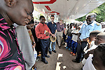 Prayer before flight, the people of Wembo Nyama pray with the crew of a United Methodist mission airplane.