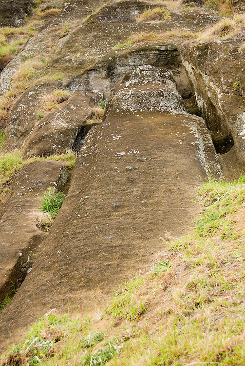 Chile, Easter Island: Sculptures at the quarry Rano Raraku where all the large sculptures were carved..Photo #: ch260-32705.Photo copyright Lee Foster www.fostertravel.com lee@fostertravel.com 510-549-2202