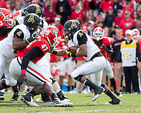 The Georgia Bulldogs beat the App State Mountaineers 45-6 in their homecoming game.  After a close first half, UGA scored 31 unanswered points in the second half.  Appalachian State Mountaineers running back Marcus Cox (14)