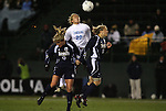 04 December 2009: North Carolina's Amber Brooks (22) outjumps Notre Dame's Lauren Fowlkes (9) and Michele Weissenhofer (11). The University of North Carolina Tar Heels defeated the Notre Dame University Fighting Irish 1-0 at the Aggie Soccer Complex in College Station, Texas in an NCAA Division I Women's College Cup Semifinal game.