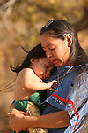 A Native American Indian mother holding her baby boy who was upset
