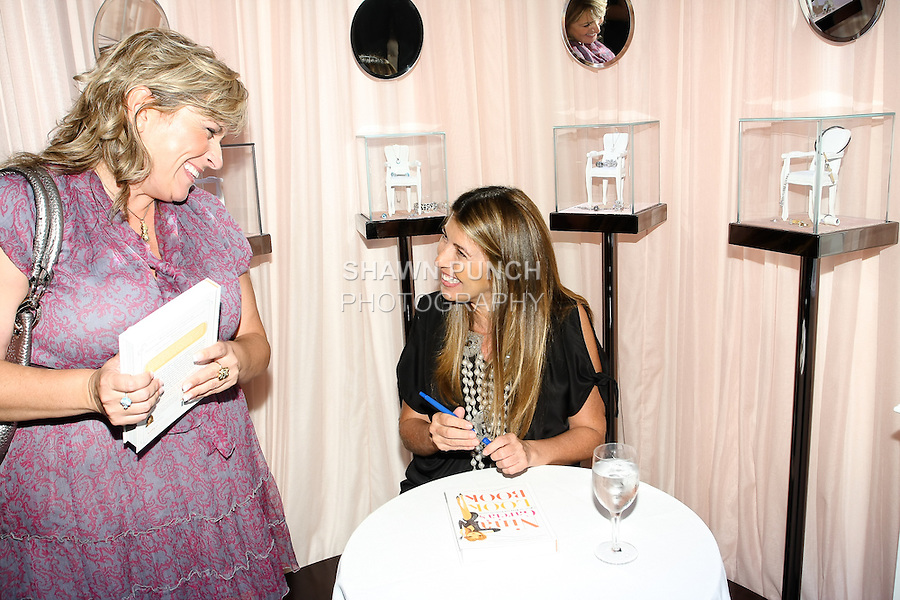 Nina Garcia's autographs a book for fan during the Nina Garcia's &quot;Look Book: What To Wear For Every Occasion&quot;, book release party with Marie Claire at Tous Rockefeller Center, August 17, 2010.
