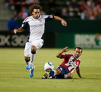 Revolution defender Kevin Alston (30) moves past Chivas midfielder Rodolfo Espinosa (24) during the first half of the game between Chivas USA and the New England Revolution at the Home Depot Center in Carson, CA, on September 10, 2010. Chivas USA 2, New England Revolution 0.