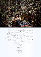 "This is a scan of a print that was given to the subject, Tim 'Timbow' Bowman, so that he could write his thoughts. He wrote:..""I work for everything I ever get By the sweat of my Brow. To steal & Beg I will never do! That's why I live here you see. I live in a Tee Pee! TimBow""..Caption for the photo:.Ventura, California, July 23, 2010 - A portrait of Tim 'Timbow' Bowman in front of his tent that is hidden by the 16-foot tall grass and bamboo on the Ventura River bottom. Bowman has been homeless and living along the river since the early 1990's.  In 1987 his 18-month-old daughter, Miranda Laurel, died from Lyme disease. His wife left him soon afterwards. A year later he fell through a plate glass window while working on a construction site, leaving him disabled and unable to work construction. He says the loss of his wife and daughter and his struggles with work sent him into a spiral. He eventually lost his home. He says he lives in the 300+ community along the river bottom because he ""feels at home."" Adding, ""I feel loved down here. Up there is nothing but trouble."" The two-mile stretch of river bottom from the Pacific to Stanley Road is home to about 300 homeless, who have carved tunnels and paths into the tall grass and bamboo. Bowman, who survives off of SSI, says, ""I lead an honest life. I don't steal, I don't rob and I share whatever I can."" .."